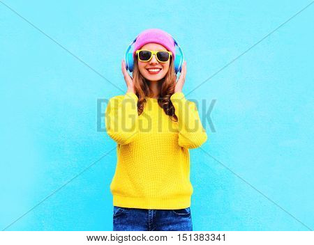 Fashion Pretty Cool Smiling Girl Listening To Music In Headphones Wearing Colorful Pink Hat, Yellow