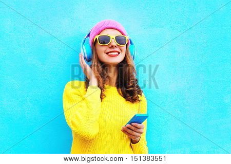Fashion Pretty Sweet Carefree Girl Listening To Music In Headphones With Smartphone Wearing Colorful