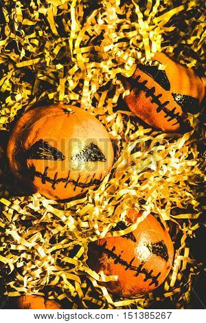 Creative spooks still life on a bunch of country pumpkin oranges celebrating a rustic rural halloween