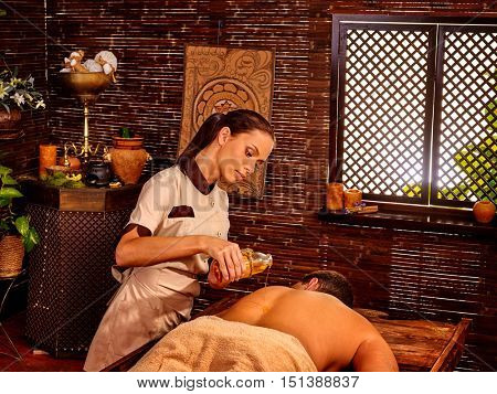 Man having oil Ayurveda spa treatment. Male exotic massage.