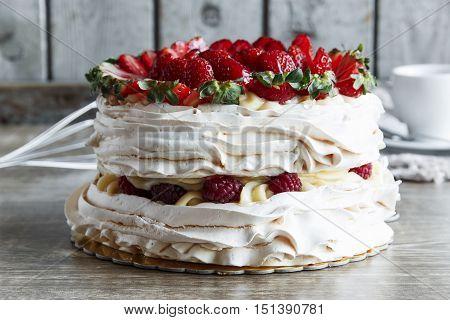 meringue cake with custard and strawberry raspberry