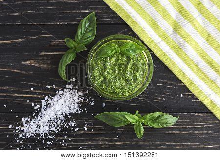 Pesto Sauce In Glass Jar, Sea Salt And Basil Leaves