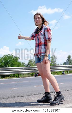 Girl hitchhiking hitchhiker woman young travel road