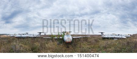 Old aircrafts at abandoned Airbase. Panoramic view of the battered aircraft