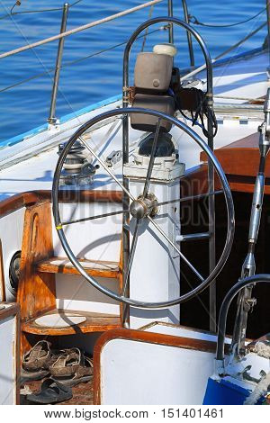 Detail of rudder and compass on a white sailboat