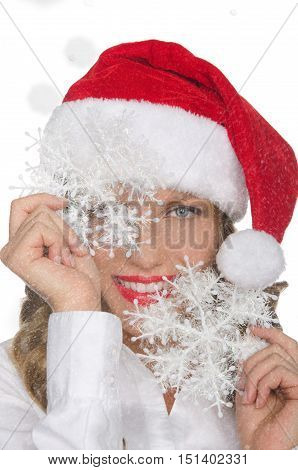 happy woman in Santa hat with snowflakes isolated on white