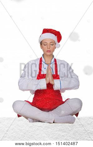 chef in hat of Santa doing yoga with snow on white background