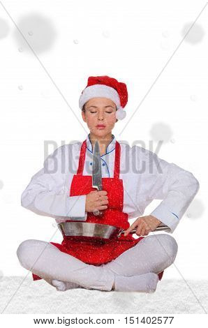Woman cook in Santa hat yoga knife under snow on white background