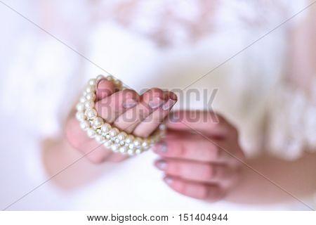 Beautiful Bride Wearing Pearl Earrings And Bracelet