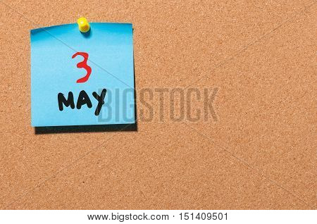 May 3rd. Day 3 of month, calendar on cork notice board, business background. Spring time, empty space for text.