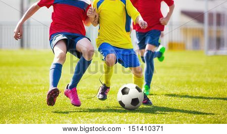 Children play football. Soccer football game for youth. School soccer tourmanet for kids
