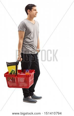 Full length profile shot of a man holding a shopping basket waiting in line isolated on white background