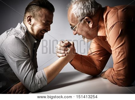 Two men arm wrestling competition.