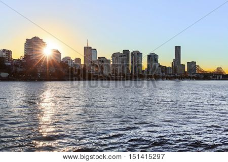 Brisbane Cityscape and Story Bridge sunset, viewed from the back of a CityCat ferry.