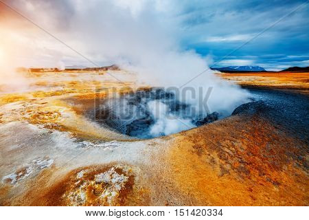 Ominous view geothermal area Hverir (Hverarond). Popular tourist attraction. Dramatic and picturesque scene. Location place Lake Myvatn, Krafla northeastern region of Iceland, Europe. Beauty world.