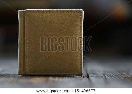 Photobook Stands On A Wooden Background.