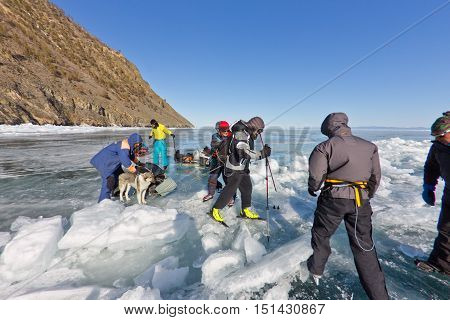 Lake Baikal, Russia, March 24. The Crossing Through The Crack In The Ice Of Lake Baikal Big Tourist