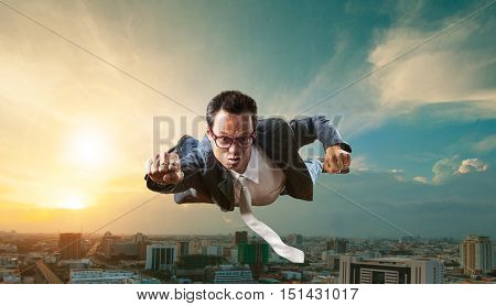 business man flying over skyscraper for business successful and competition concept