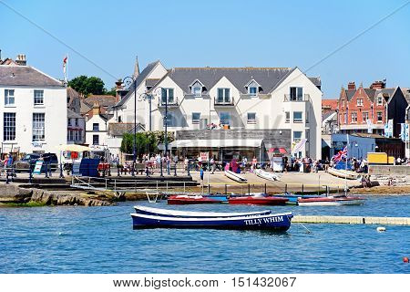 SWANAGE, UNITED KINGDOM - JULY 19, 2016 - View of boats moored in the bay and the beach and waterfront buildings to the rear Swanage Dorset England UK Western Europe, July 19, 2016.