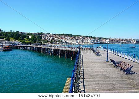SWANAGE, UNITED KINGDOM - JULY 19, 2016 - View along the Victorian pier towards the beach and town Swanage Dorset England UK Western Europe, July 19, 2016.
