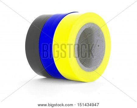 Black blue yellow insulating tape reels isolated on white background