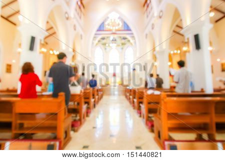 Blurred Christian Mass Praying Inside The Church