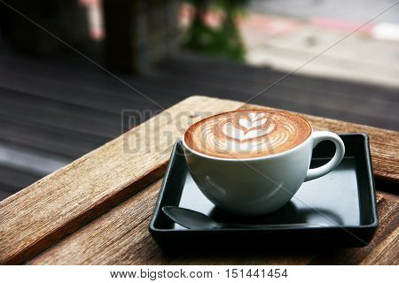 latte art on wooden table in morning