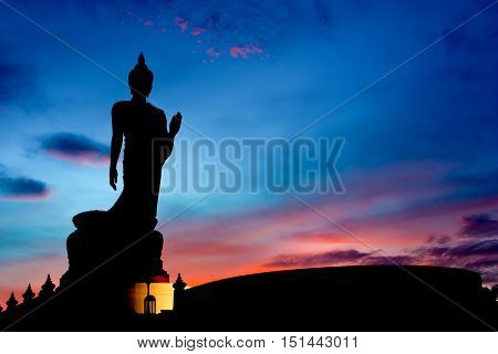 Silhouette Of The Posture Of Walking Buddhist Statue In Twilight poster