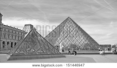 PARIS, FRANCE OCTOBER 20, 2014: View of Inverted Pyramid (architect Pei Cobb Freed) in Louvre Museum at sunset. With 8.8 million annual visitors, Louvre is consistently most visited museum worldwide.