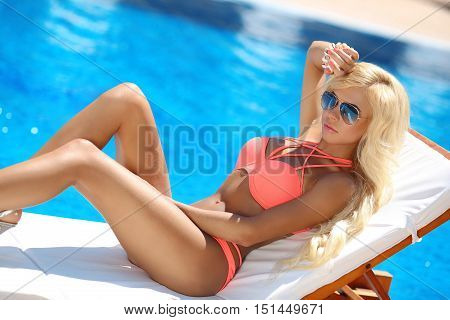 Beautiful Sexy Woman Bikini Model Posing And Tanned On Deck Chair By The Blue Swimming Pool,summer V