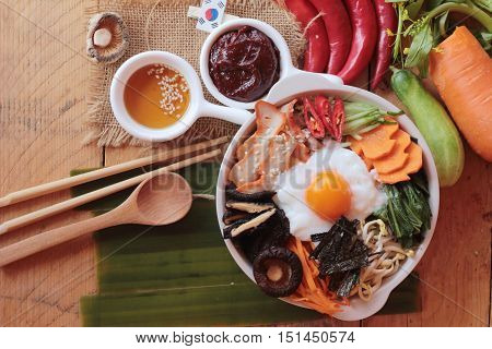Bibimbap korean food is delicious on wood background