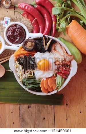 Bibimbap korean food is delicious on wood background