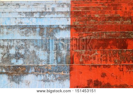 Concrete blue and red bleachers steps in horizontal 3:2 format.