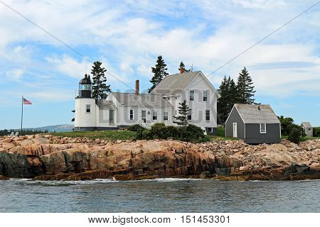 Lighthouse on the rocky coast of Maine