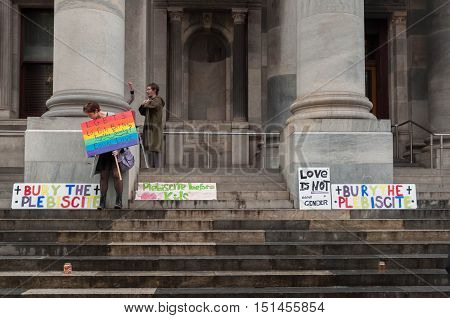 ADELAIDE, AU - SEPTEMBER 4, 2016: South Australians supporters of marriage equality gather outside Parliament House to express opposition to the Australian Federal Government's plan for the 2017 plebiscite.
