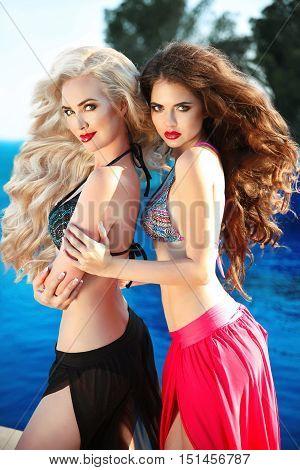 Beautiful Sexy Women Posing In Swimsuit. Bikini Models With Long Wavy Hair And Makeup. Fashion Outdo