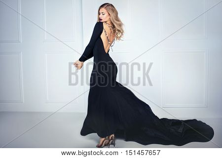 Elegant Sexy Woman In Black Dress.
