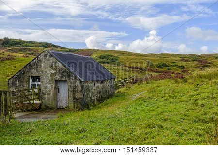 Old stone outbuilding in the beautiful rural landscape of Isle of Skye Scotland