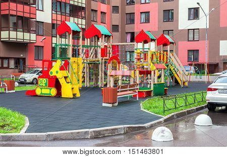 ST PETERSBURG RUSSIA - JULY 28 2016: Colorful сhildren's playground for kids in new district with many slides swings toys for play