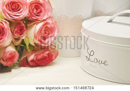 box with love text and pink roses (soft focus,lens blur)