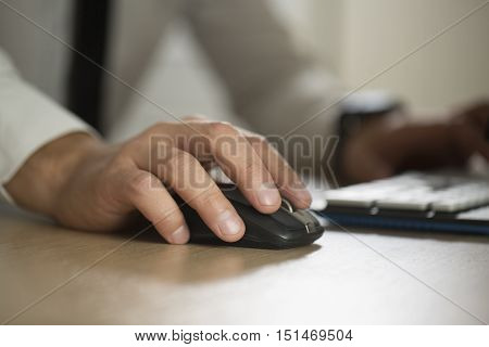 Hand Of Businessman Use Computer Mouse And Typing, Partnership A