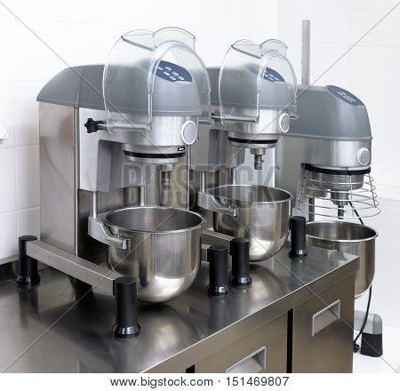 kneading machine in a restaurant kitchen .