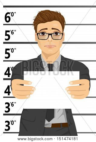 Arrested businessman posing for a mugshot holding a signboard poster
