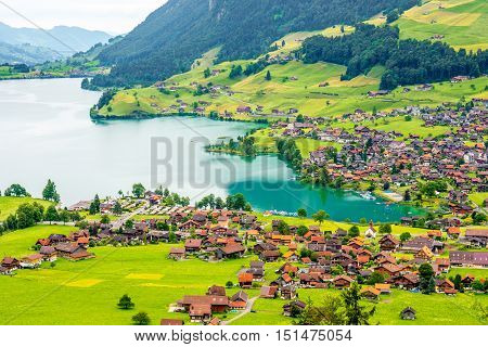 Beautiful rural landscape view on the green mountains and village in Switzerland