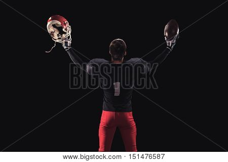 Soccer player on a dark background in vintage style. The classic American game. college Students. celebrates victory