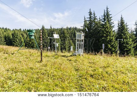 Weather station in the clearing of the forest.