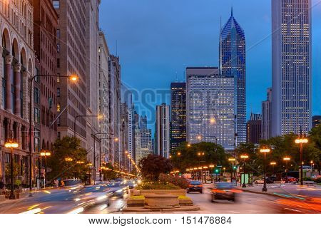 Michigan Avenue in Chicago. Image of busy traffic at Chicago night street.