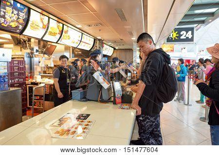 HONG KONG - NOVEMBER 03, 2015: McDonald's in Hong Kong International Airport. McDonald's is the world's largest chain of hamburger fast food restaurants.