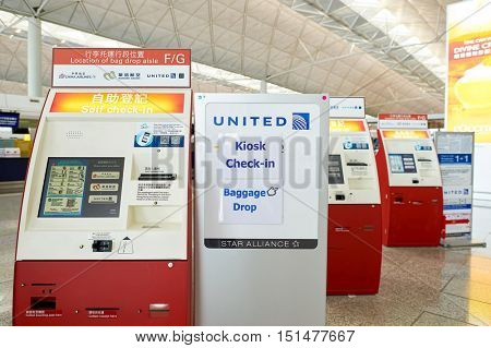 HONG KONG - NOVEMBER 03, 2015: self check-in counters at Hong Kong Airport. Hong Kong International Airport is the main airport in Hong Kong. It is located on the island of Chek Lap Kok.