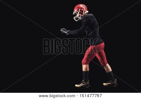 Soccer player on a dark background in vintage style. The classic American game. college Students